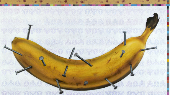 """The banana represents a sensitive person who is suffering from the nails sticking into him, said Oussama Diab. The artwork is called """"Human Being."""""""