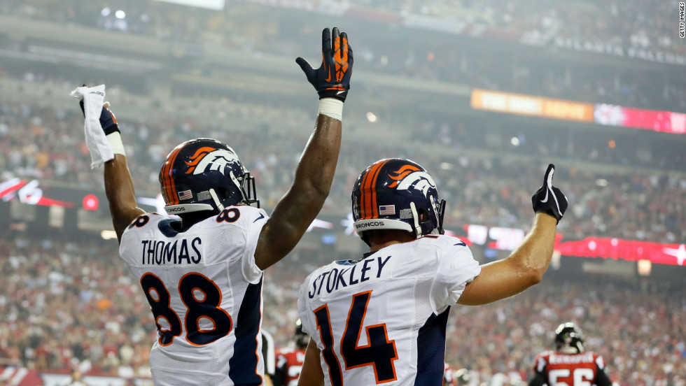 Demaryius Thomas, left, and Brandon Stokley of the Denver Broncos celebrate after a touchdown Monday against the Atlanta Falcons.