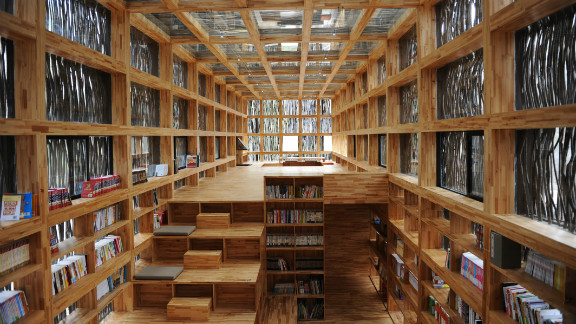 Located on the outskirts of Beijing, the single-storey Liyuan Library is cloaked in firewood so as to blend in with the surrounding tree life. Designed by: Li Xiaodong, China