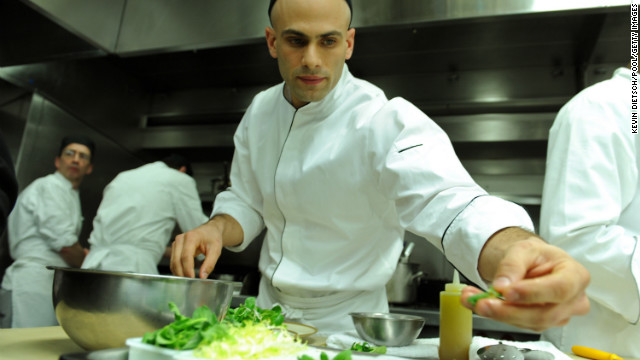 White House assistant chef Sam Kass prepares dinner for a 2009 White House event.