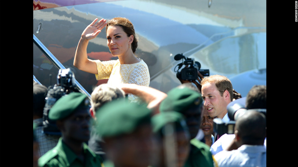 Catherine, Duchess of Cambridge, waves goodbye to onlookers as she and Prince William board a plane to leave the Solomon Islands from Honiara on Tuesday, September 18.