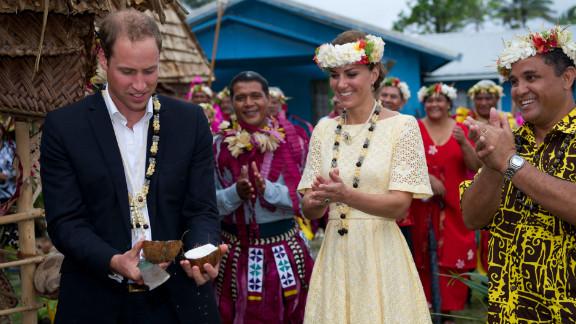 Prince William opens a coconut with a machete as Catherine, Duchess of Cambridge, watches on Tuesday in Tulavu.