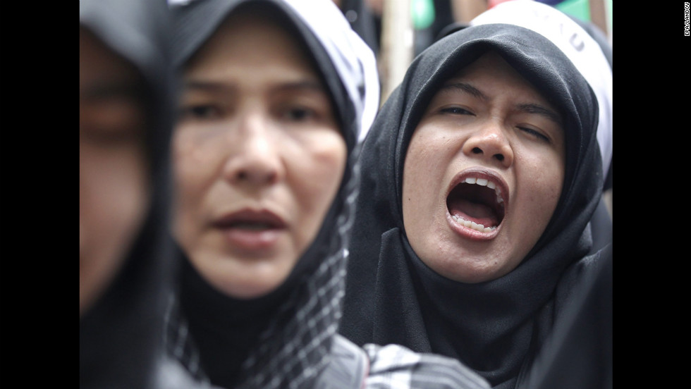 Thai Muslims shout slogans during a protest in Bangkok, Thailand, on Tuesday.