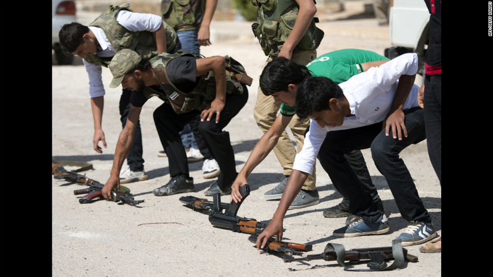 Volunteers train with rifles on the outskirts of Azaz on Wednesday.