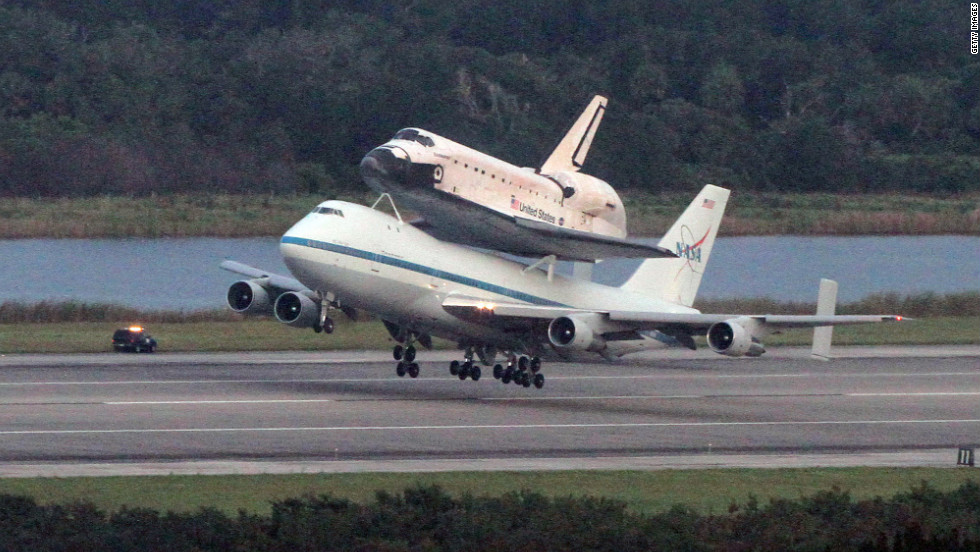 Perched atop a modified Boeing 747, Endeavour departs Kennedy Space Center in Florida at 4:22 Wednesday morning.