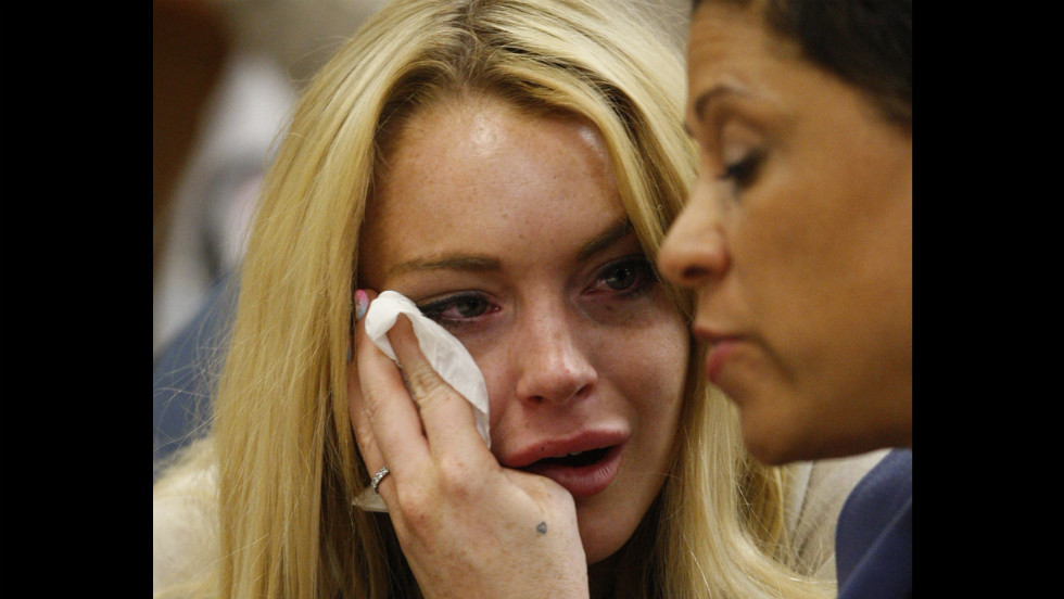 Lohan cries next to her lawyer Shawn Chapman Holley as she is sentenced to 90 days in jail by Judge Marsha Revel during her hearing at the Beverly Hills Courthouse in July 2010. Lohan violated her probation in two 2007 drunk driving cases.