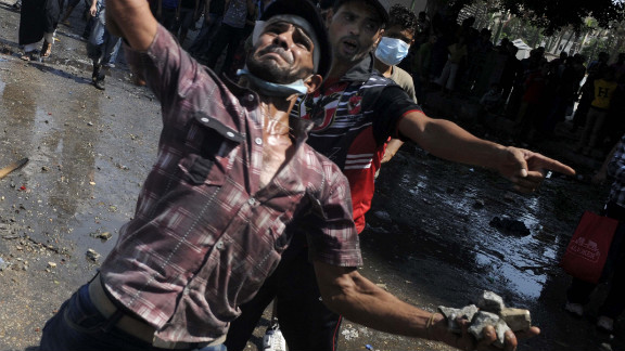 Protesters throw stones at police during clashes against an anti-Islam film near the U.S. Embassy in Cairo on Friday.