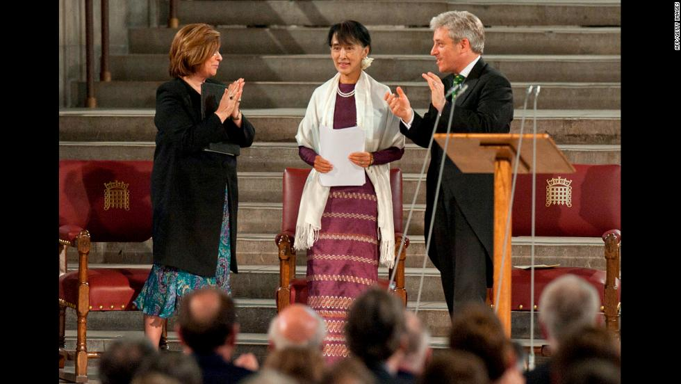 Suu Kyi stands to address both houses of Parliament in Westminster Hall, London, on June 21, 2015 as Speaker of the House of Commons John Bercow, right, and Speaker of the House of Lords Baroness D'Souza stand beside her. Suu Kyi made a historic address to both houses of the British Parliament, making her only the fifth foreign dignitary since World War II to be accorded the rare honor.