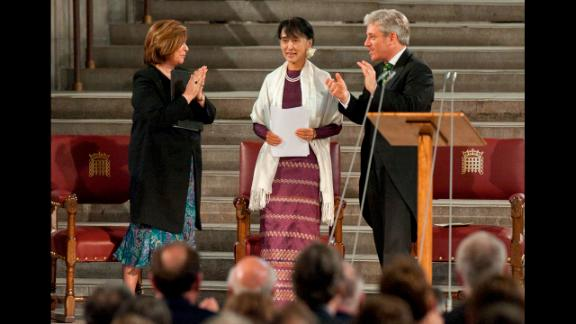 Suu Kyi stands to address both houses of Parliament in Westminster Hall, London, on June 21, 2015 as Speaker of the House of Commons John Bercow, right, and Speaker of the House of Lords Baroness D
