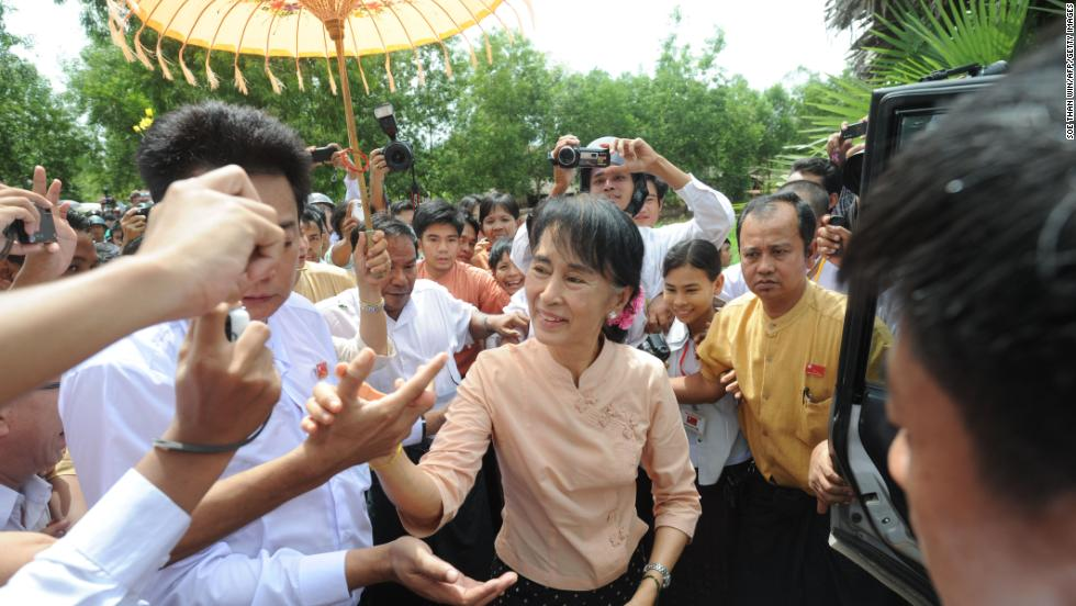 Suu Kyi greets her supporters as she visits a recently flooded area in Pathein township, the capital city of the Irrawaddy division, on September 1, 2015. Heavy monsoon rains in Myanmar forced tens of thousands of people to seek shelter in emergency camps.