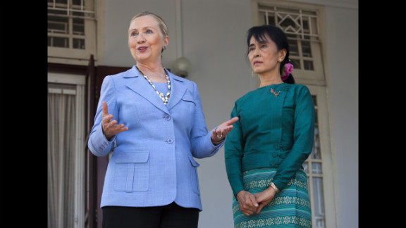 Suu Kyi and Secreatary of State Hillary Clinton stand together during a news conference after their meeting at her residence in Yangon on December 2, 2011, where they laid out a framework for reforms.