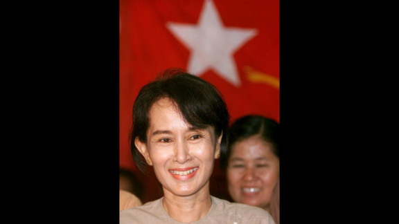 Suu Kyi listens to a question during a news conference after being freed from 19 months under house arrest May 6, 2002, making a triumphant return to her party