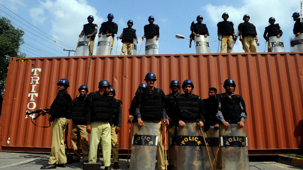 Pakistani police stand guard on a blocked street in front of the U.S. Consulate during a protest in Lahore on Wednesday.