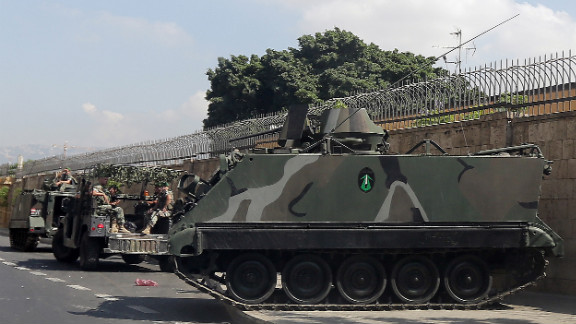 Lebanese army soldiers secure the area around the French ambassador