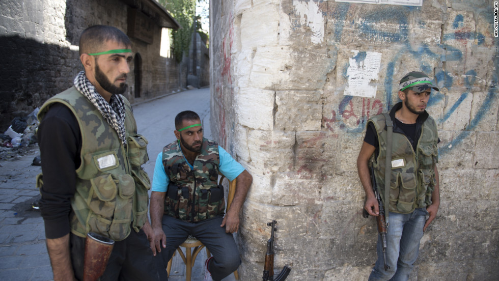 Syrian rebel fighters man a checkpoint in Aleppo on Thursday.