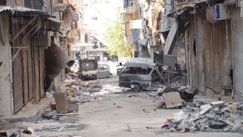 Damaged buildings and cars are seen in the al-Midan neighborhood of Aleppo after Free Syrian Army fighters and forces loyal to President Bashar al-Assad clashed on Thursday.