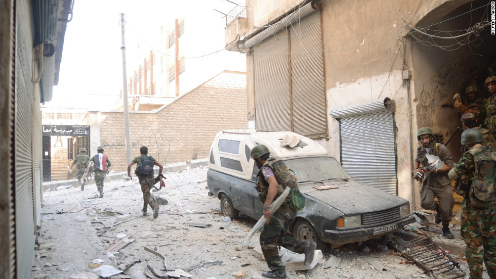 Forces loyal to President Bashar al-Assad appear in Aleppo's Suleiman al-Halabi neighborhood Thursday, September 20.