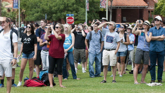 Students and faculty at the University of Arizona watch as Endeavour flies over the campus in Tucson, Arizona, on Thursday. Endeavour reportedly flew over Tucson to honor former Arizona Rep. Gabrielle Giffords and her husband, retired astronaut Mark Kelly, who commanded Endeavour's final mission to space in May 2011.