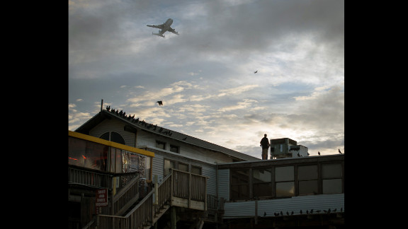 Endeavour is flown over the pier in Cocoa Beach, Florida, on Wednesday.