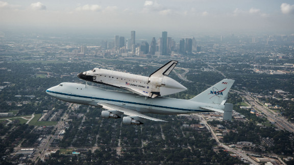 Space shuttle Endeavour is ferried by NASA's shuttle carrier aircraft as it flies over Houston on Wednesday, September 19. After a two-day delay due to unfavorable weather, Endeavour began its flight to Los Angeles on Wednesday.