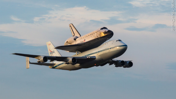 Endeavour and the shuttle carrier aircraft pass back over NASA