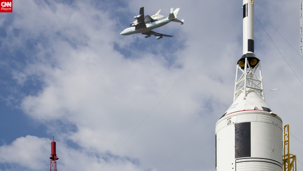 "Endeavour <a href=""http://ireport.cnn.com/docs/DOC-843801"">flies over retired rockets</a> at Johnson Space Center in Texas."