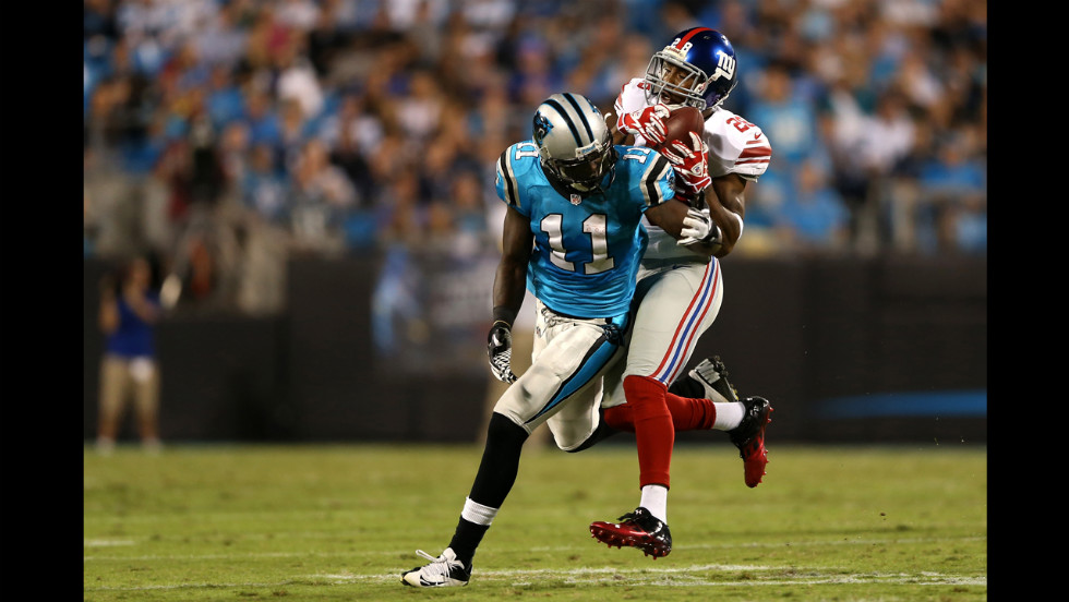 Jayron Hosley of the New York Giants intercepts a pass intended for Brandon LaFell of the Carolina Panthers on Thursday.