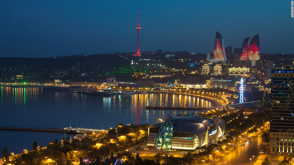 The Flame Towers of Baku, Azerbaijan, twist sensually high above the capital's skyline. They are covered in LED screens and at night flicker like fire, visible from all points in the city.