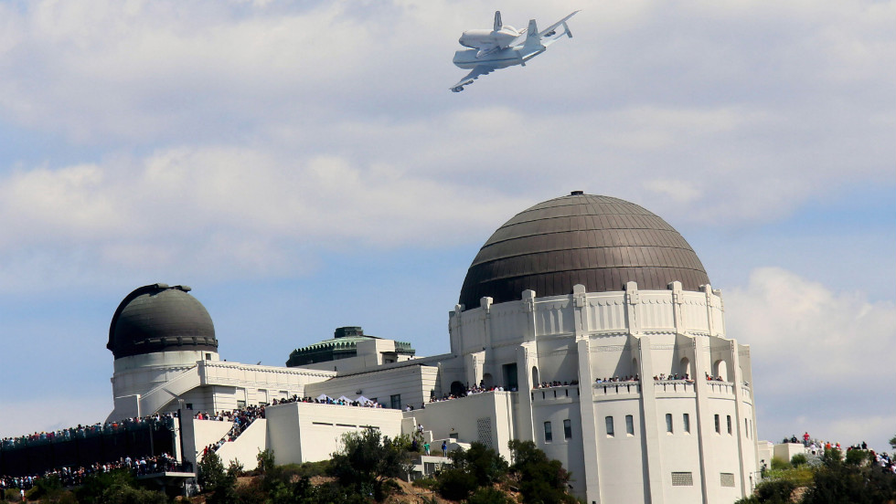 Endeavour flies over the Griffith Park Obervatory on Friday in Los Angeles.