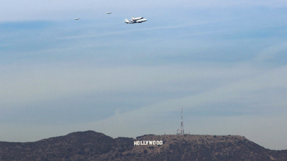 Endeavour flies low over the Hollywood sign as it travels toward its final destination in Los Angeles on Friday.
