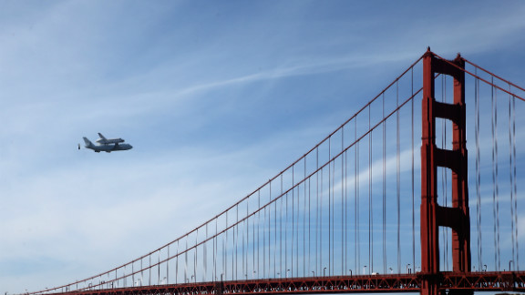 Space shuttle Endeavour passes over the Golden Gate Bridge before making its final landing in Los Angeles on Friday, September 21. The shuttle passed over California landmarks before heading to the airport. Endeavour will be placed on public display at the California Science Center. This is the final ferry flight scheduled in the Space Shuttle Program era. See more of CNN's best photography.