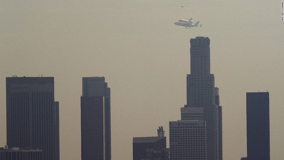 Endeavour flies over the U.S. Bank Tower, the tallest building in California, in downtown Los Angeles on Friday.