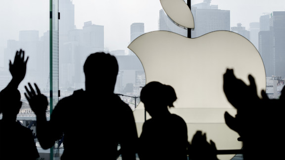 Apple employees greet a customer in Hong Kong.