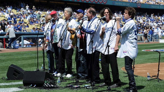 The group poses for a photo before they perform the national anthem on Opening Day at Dodger Stadium as the Los Angeles Dodgers take on the Pittsburgh Pirates in April 2012 in Los Angeles. The Beach Boys are celebrating their 50th anniversary, along with Dodger Stadium.