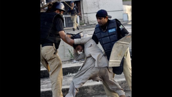 "Pakistani police detain a demonstrator in Lahore on Friday during a protest against the film ""Innocence of Muslims."""