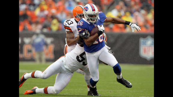 Brad Smith of the Buffalo Bills runs by Cleveland Browns defenders.