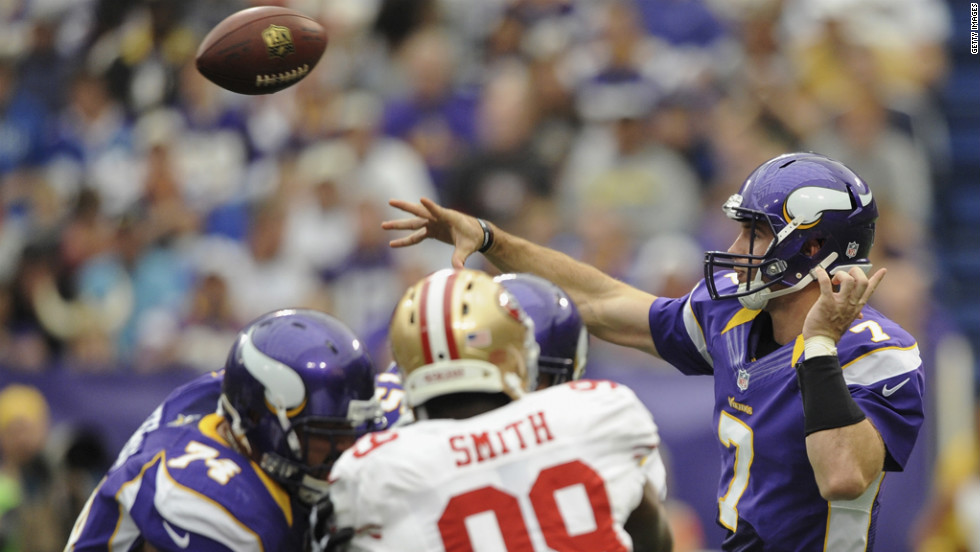 Christian Ponder of the Vikings fires a pass downfield.