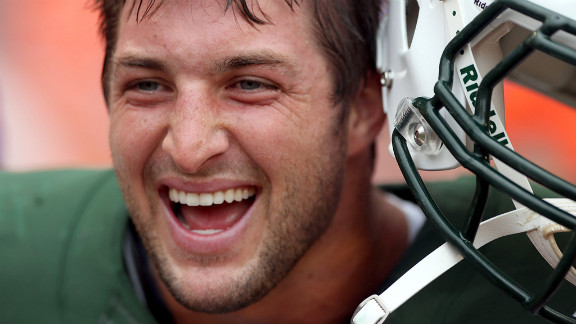 New York Jets backup quarterback Tim Tebow smiles before Sunday