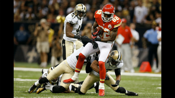 Dwayne Bowe of the Kansas City Chiefs is tackled during Sunday