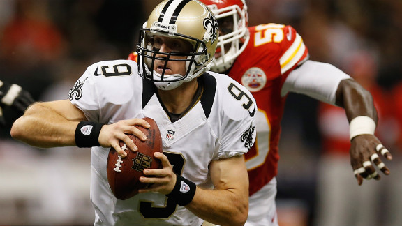 Brees scrambles to get away from the Chiefs