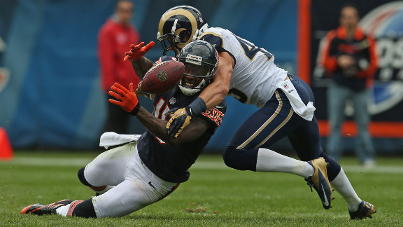 Brandon Marshall of the Bears tries to catch a pass Sunday as he is hit by the Rams