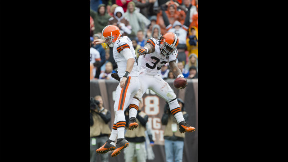 Browns quarterback Brandon Weeden, left, celebrates with Richardson after the rookie running back