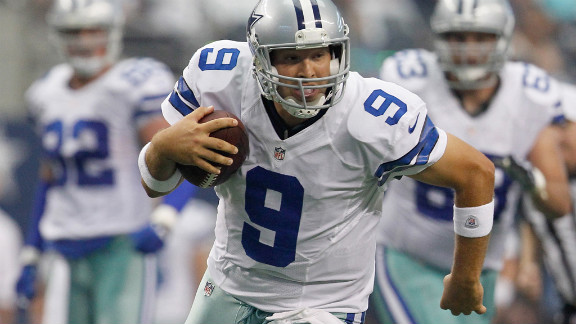 Cowboys quarterback Tony Romo runs for daylight against Tampa Bay.