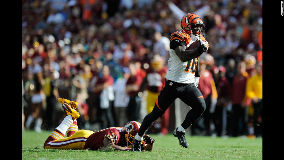 Andrew Hawkins of the Cincinnati Bengals avoids a tackle by the Washington Redskins' Richard Crawford on his way to scoring a game-winning touchdown Sunday in Landover, Maryland. The Bengals won 38-31.