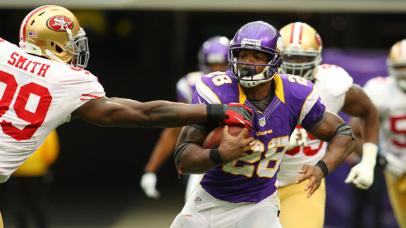 Aldon Smith of the 49ers attempts to snag the ball from Adrian Peterson of the Vikings on Sunday.