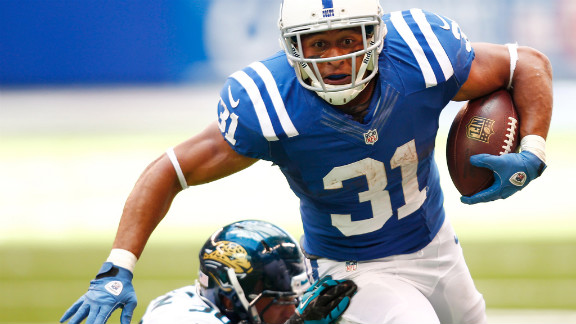 Donald Brown of the Colts runs the ball as Russell Allen of the Jaguars makes the tackle from behind.