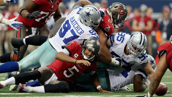 No. 5 Josh Freeman of the Tampa Bay Buccaneers fumbles the ball during Sunday