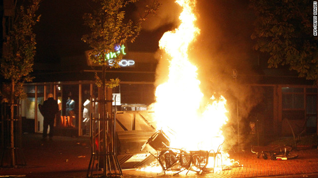 Chairs burn in the Dutch town of Haren late on September 21, 2012 after a teenager's birthday invite on Facebook went viral.