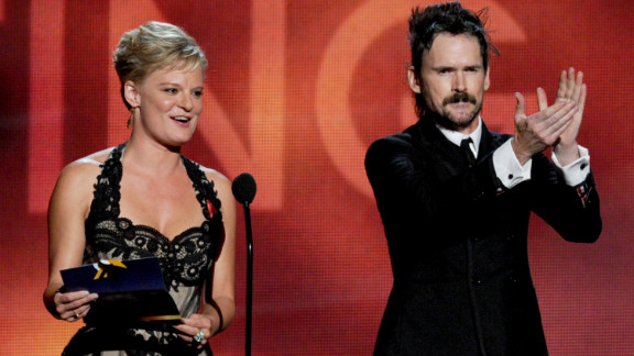 """Martha Plimpton, winner of best guest actress in a drama for """"The Good Wife,"""" and Jeremy Davies, winner of best guest actor in a drama for """"Justified,"""" address the audience."""