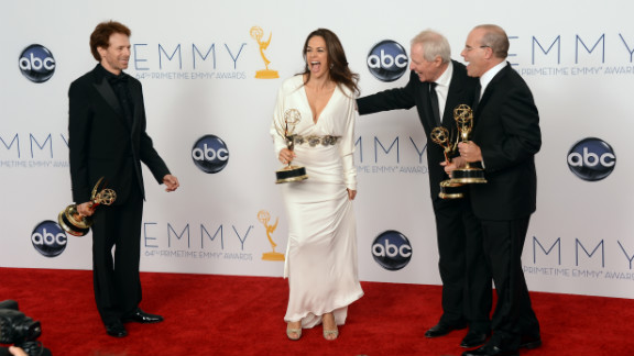"""From left, producers Jerry Bruckheimer, Elise Doganieri, Bertram van Munster and Jonathan Littman celebrate winning in the outstanding reality-competition category for """"The Amazing Race."""""""